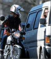 Rider talking to van driver